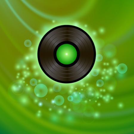 Retro Vinyl Disc on Green Blurred Background