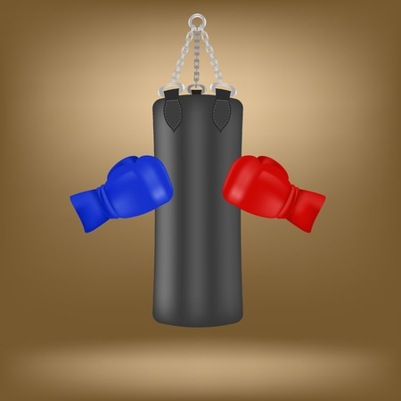 Boxing Gloves and Black Sport Bag Isolated on Brown Background