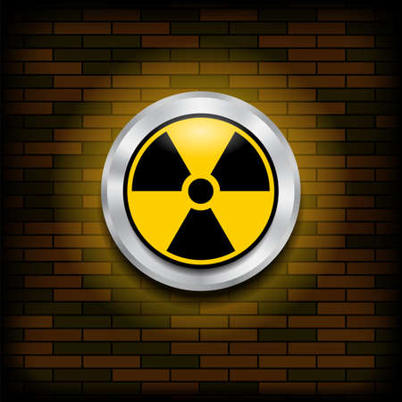 Ionizing Radiation Sign. Radioactive Contamination Symbol. Warning Danger Hazard on Orange Brick Wall