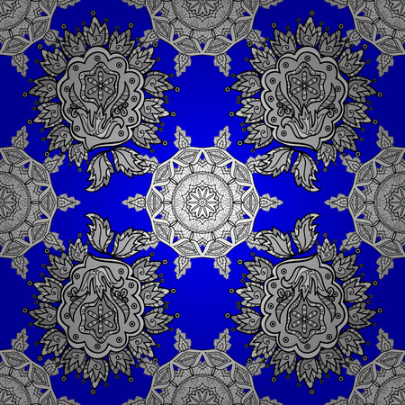 Oriental seamless pattern of white flowers and mandalas. Vector blue background. Illustration