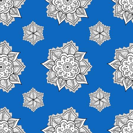 motivos navideños: Circular seamless pattern. Ornamental texture mandala. Blue and white graphics, painted by hand. Snowflake, New Year, Christmas?