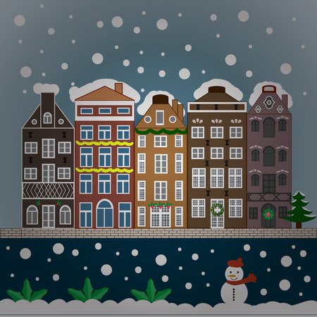 Snowfall on Christmas eve. Winter day in cosy town street scene. Classic European houses landscape with Christmas holiday decorations. Buildings and facades.