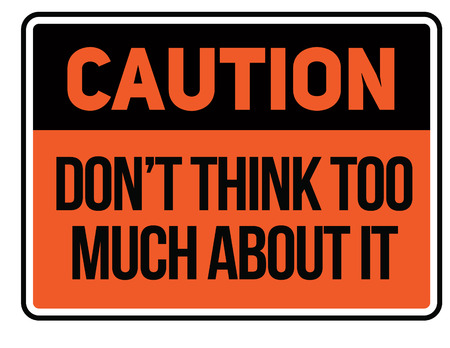 Caution do not think too much about it Warning sign simple colours