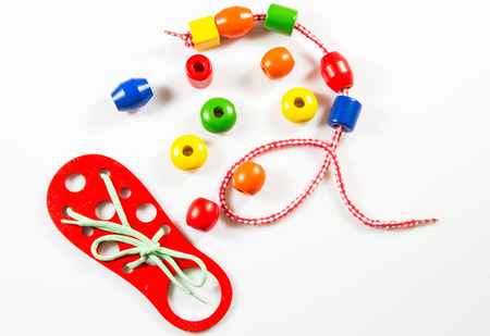 Toys, development, motor skills, lacing, beads