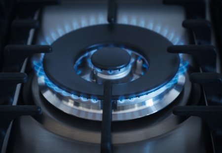 Blue flames from gas kitchen range photo