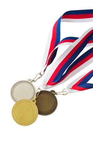 Three medals hanging from a red, white and blue ribbon isolated on white background photo