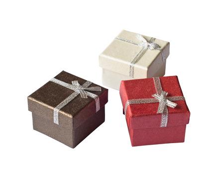 three gift boxes: Tres cajas de regalo con cinta de plata aislado en blanco Foto de archivo