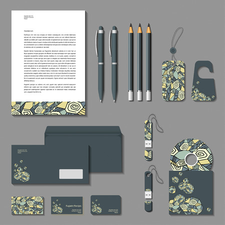 Vector corporate identity poligonal design. Cards, letter, envelope, business cards, pencils, pens, tags, flash memory.