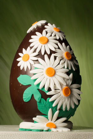 Easter chocolate egg decorated with sugar daisies