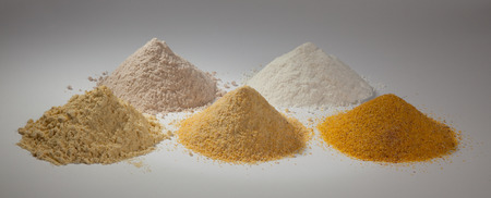 pureness: rice flour, sorghum and three different types of corn flour on a white background