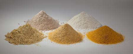 cornflour: rice flour, sorghum and three different types of corn flour on a white background