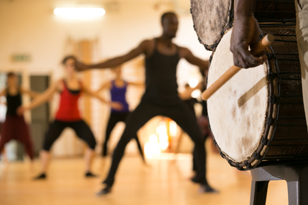Dance class with instructor and close up of African drums Stock Photo