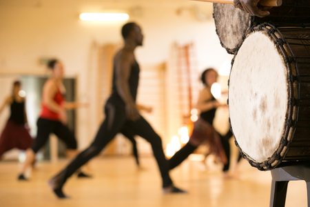 african drums: Dance class with instructor and close up of African drums Stock Photo