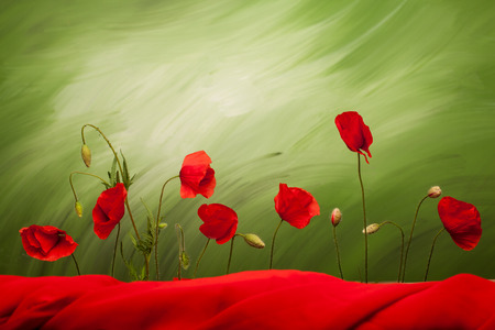 top 7: Seven poppy flowers and buds on green background with red cloth