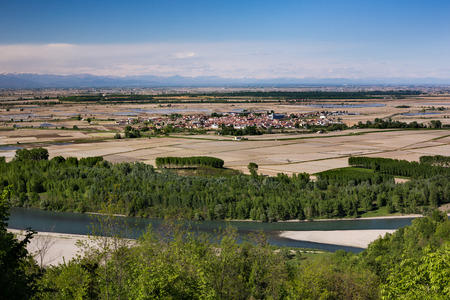 cropland: Palazzolo seen from above, surrounded by uncultivated rice fields, with Po river in foreground