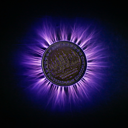 Electric discharge going through German Euro coin Stock Photo