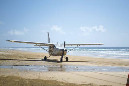Shot of a Light Aircraft on Beach on Fraser Island, Australia Stock Photo