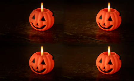 lighted candles in the form of a Jack pumpkin on a wooden background. Halloween