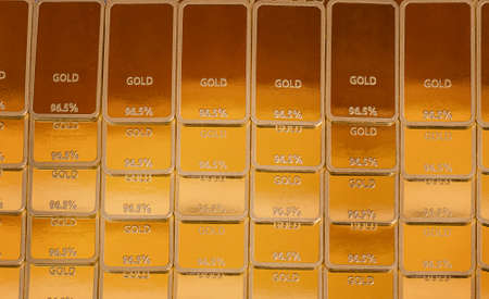Ingot background. Gold bars in rows
