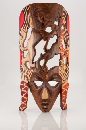 The photo shows the wooden african mask