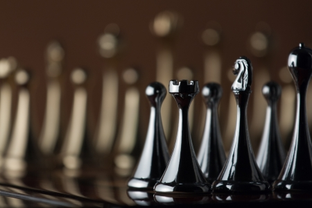 The photo shows the black chess castle and other figures  Stock Photo