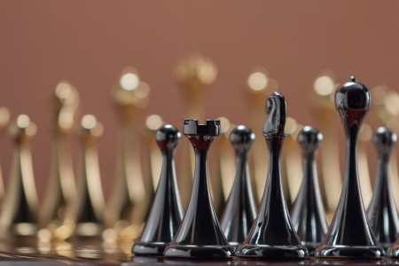 The photo shows the metal chess figures