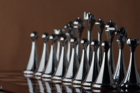 The photo shows the line of black chess figures  Stock Photo