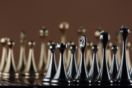 The photo shows the black metal chess figures