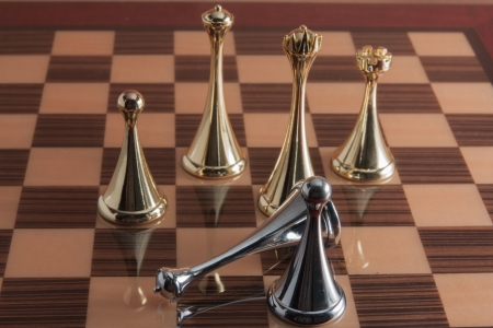 The photo shows the fallen black chess king