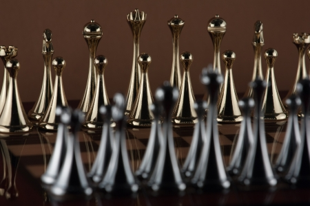 The photo shows the golden chess figures  Stock Photo