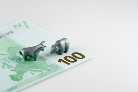 This photo shows the fragment of one hundred euro and the metal bear and the metal bull like symbol of stock gamblers
