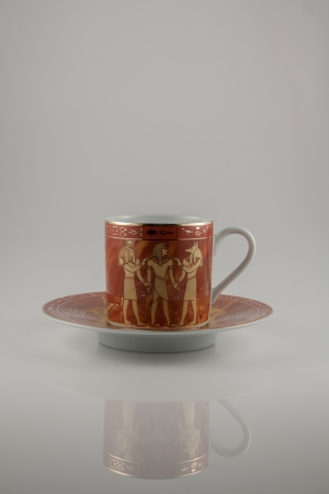 The photo shows the cup with egyptian pattern.
