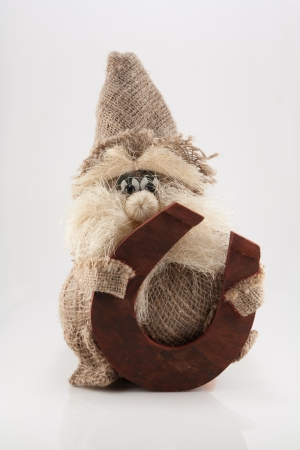 The photo shows the rag doll of hobgoblin with horseshoe  Stock Photo