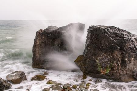 The photo shows the split rock  Stock Photo
