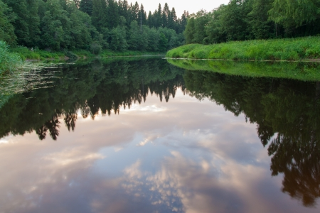 The photo shows sunset on the river. Stock Photo