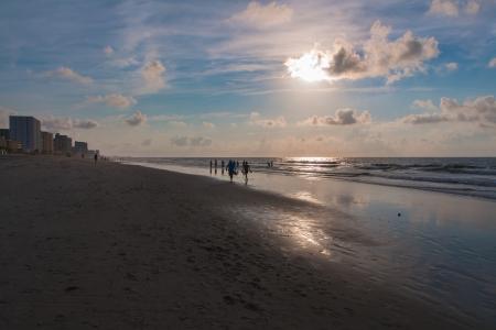 The photo shows the sunrise on the beach.