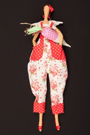 The photo shows the doll with carrots. Stock Photo