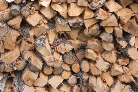 The photo shows the stack of firewood. Stock Photo