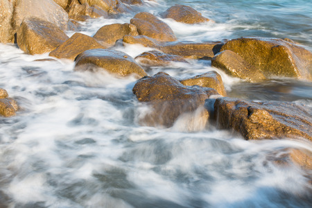 Pictured the stones on the coast with water in motion blur.