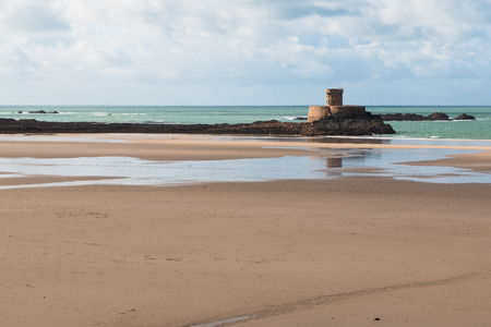 In the photo you can see a winter sunny day on the beach of Jersey in the English Channel.