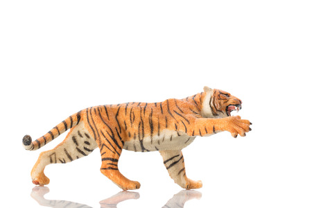 Photo shows the toy tiger on white.