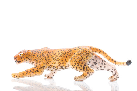 Photo shows the toy leopard on white.
