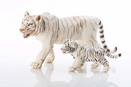 Photo shows the toy white tigers on white.