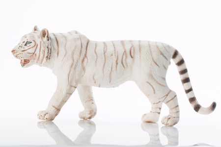 Photo shows the toy white tiger on white.