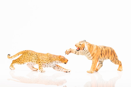 Photo shows the toy jaguar and tiger on white.