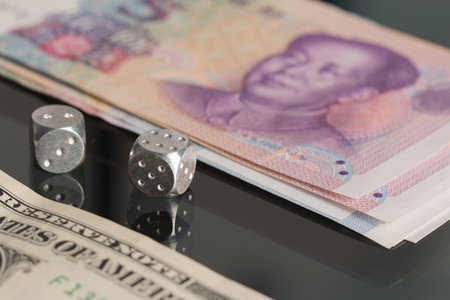 The photo shows concept: dollar vs yuan. Stock Photo