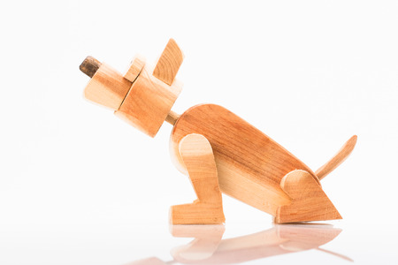 In the picture you can see an old toy wooden dog.