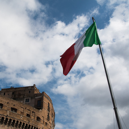 In the photo you see an Italian flag on the background of the Roman sky.