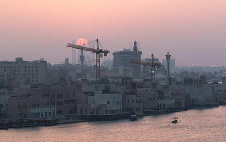 In the photo you can see the beautiful sunset at Dubai Creek.