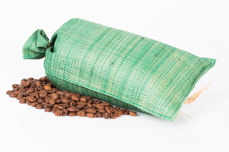 In the photo you see a canvas bag and coffee beans. 스톡 콘텐츠